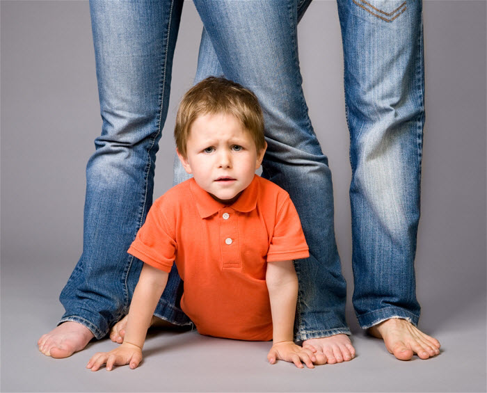 child between parents' legs