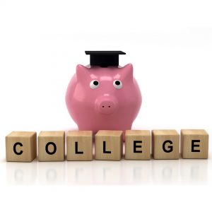 piggy bank on top of blocks that spell college