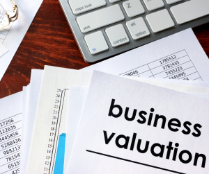 desk with financial forms, business valuation